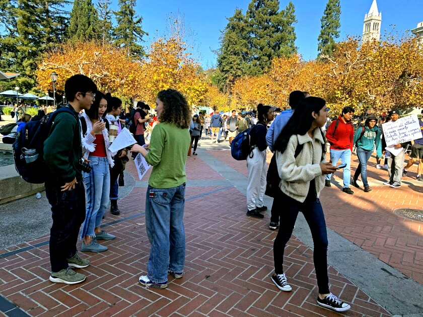 Demonstrators gather outside the Amazon store on UC Berkeley's campus on Nov. 19 to protest data-mining company Palantir. Students at colleges across the country have been protesting Palantir and other tech companies that have ties to Immigration and Customs Enforcement.