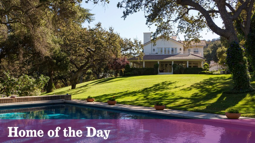 The relaxed setting includes a main house, four guest cottages, a pool, a private pond and equestrian facilities on more than 60 acres in Hidden Valley.