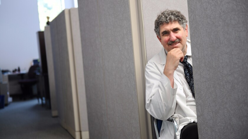 Dr. Neil Wenger, director of the UCLA Health Ethics Center, is trying to figure out how to implement a new law going into effect that will allow doctors to give terminally ill patients medicines to end their lives.