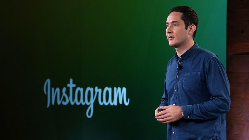 FILE - Instagram Founders To Step Down From Company