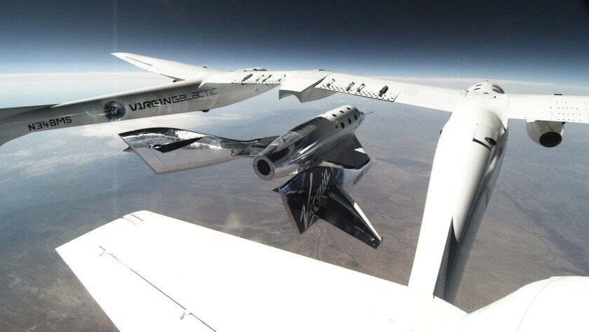 This photo provided by Virgin Galactic shows SpaceShipTwo Unity being released from the carrier mothership, VMS Eve for second successful glide flight in New Mexico on Thursday, June 25, 2020. Virgin Galactic is celebrating the second successful glide flight of its spaceship over Spaceport America in southern New Mexico. (Virgin Galactic via AP)