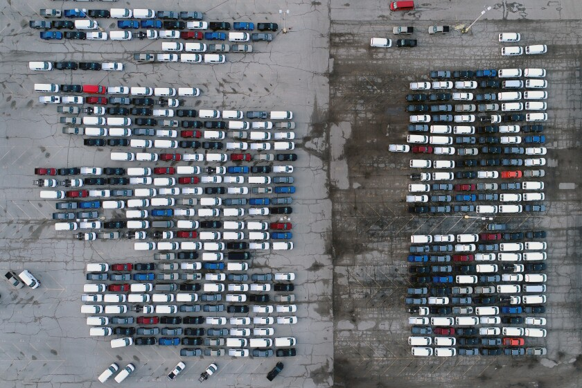 FILE - In this Wednesday, March 24, 2021 file photo, mid-sized pickup trucks and full-size vans are seen in a parking lot outside a General Motors assembly plant where they are produced in Wentzville, Mo. General Motors says efforts to manage the global computer chip shortage have worked better than expected, so it's financial results will improve over previous forecasts. The company says in a statement Thursday, June 3, it has made engineering changes, prioritized semiconductor use and pulled some potential deliveries into the second quarter. (AP Photo/Jeff Roberson, File)
