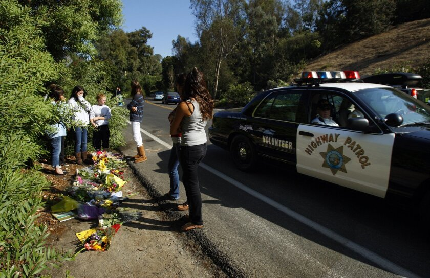 At the site of a fatal car crash in Rancho Santa Fe yesterday, friends of the five Torrey Pines High School students involved in the Sunday morning accident gathered and left flowers and notes with their condolences that intermingled with a rearview mirror, a piece of a headlight, a Mazda emblem a