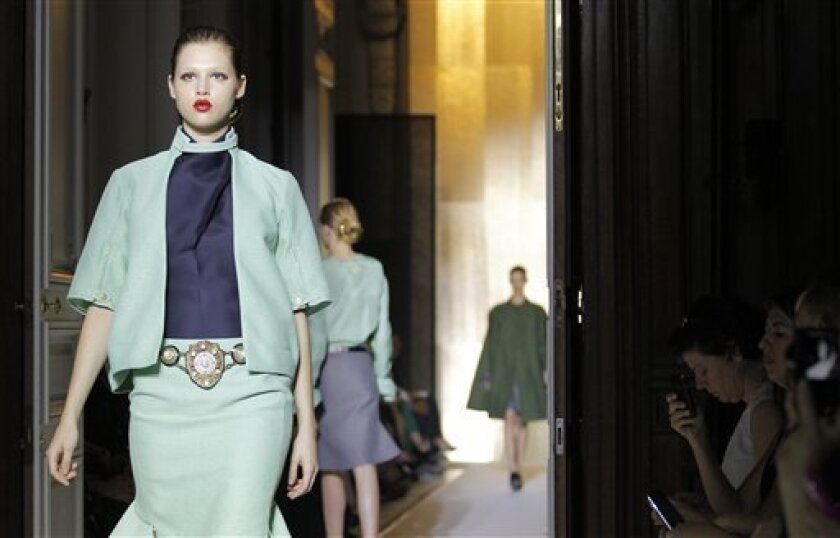 Models displays creations by Italian designer Stefano Pilati for Yves saint Laurent spring-summer 2012 ready to wear collection presented , Monday, Oct. 3, 2011, in Paris. (AP Photo/Jacques Brinon)
