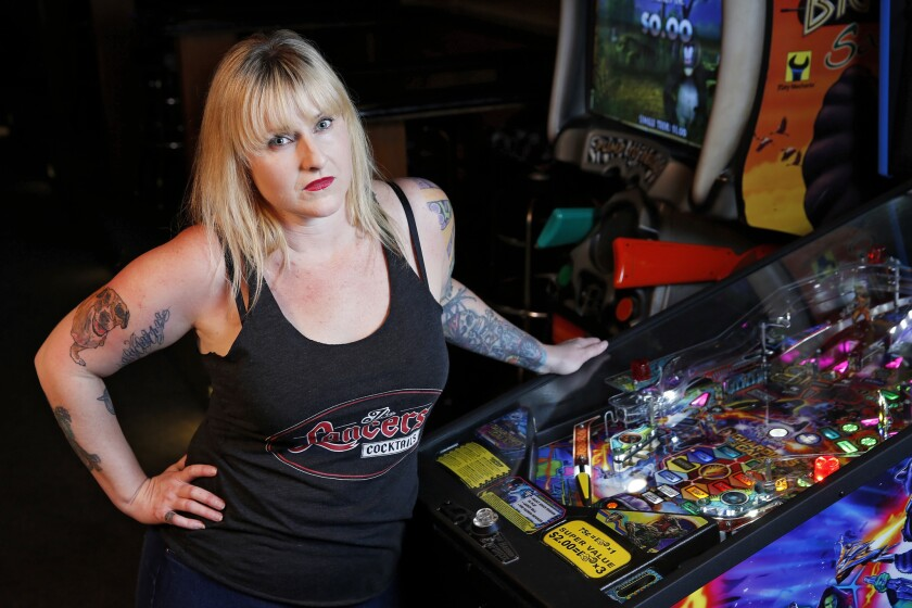 Lisa Johnson tends bar at Lacners in University Heights.