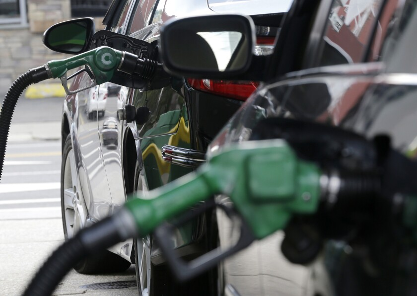 Gas is pumped into vehicles at a BP gas station in Hoboken, N.J., in June.