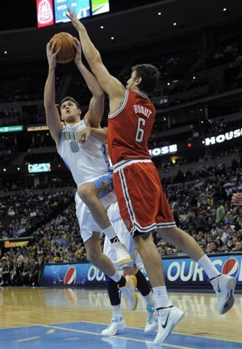 Denver Nuggets forward Danilo Gallinari (8), from Italy, takes a shot against Milwaukee Bucks center Andrew Bogut (6) during the third quarter of an NBA basketball game in Denver, Monday, Jan. 2, 2012. (AP Photo/Jack Dempsey)