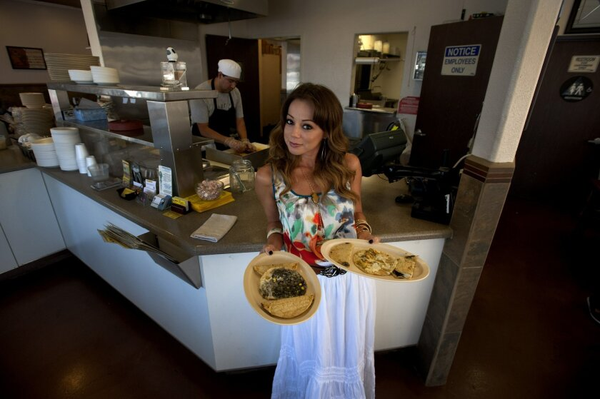 Chef Marcela Valladolid stands inside one of her favorite spots in Chula Vista, Aqui es Texcoco.