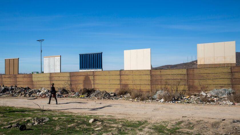 TIJUANA, B.C., MEX - FEBRUARY 01: Nina Magnusdottir walks along the border, while with a tour group