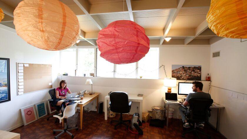 Marian Belgray (left) and Josh Zetumer share office space.