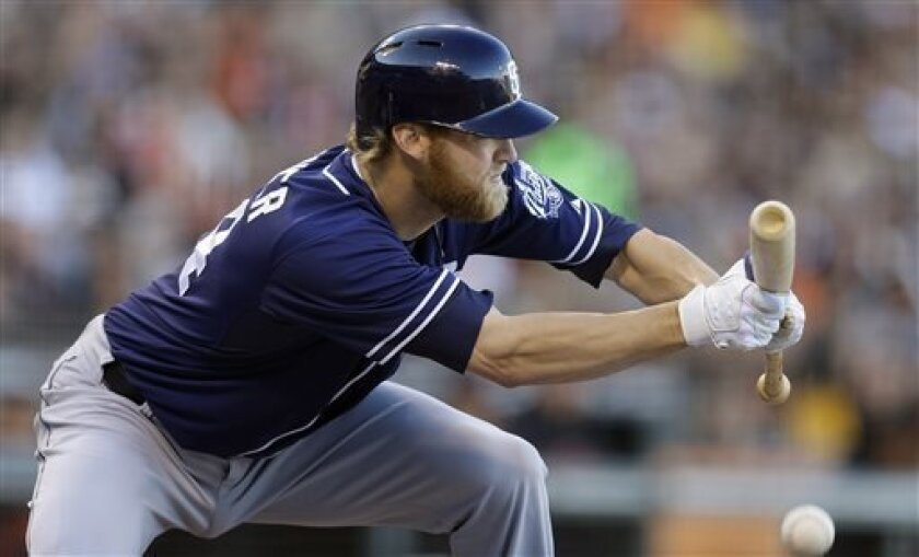 Bunting is not just a sacrificial act for Padres pitcher Andrew Cashner, who approaches each plate appearance as a chance to use his speed, but also fields his position with a rare athleticism. (AP Photo/Ben Margot)
