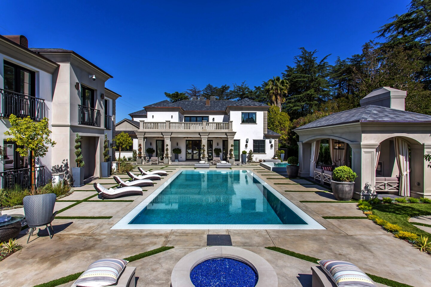 Grammy-winning producer Philip Lawrence shelled out $10.55 million for the Encino home of former Dodger Jimmy Rollins. The neoclassical-inspired home sits behind gates on more than half an acre with a sports court, a resort-style swimming pool and a guesthouse. A wine cellar, an indoor sauna and a grand domed entry are among features of the 14,900-square-foot mansion, which was built in 2017.