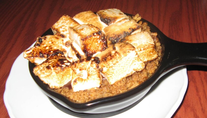 Cast-iron s'mores dessert at Green Dragon Tavern & Museum in Carlsbad. CREDIT: Pam Kragen