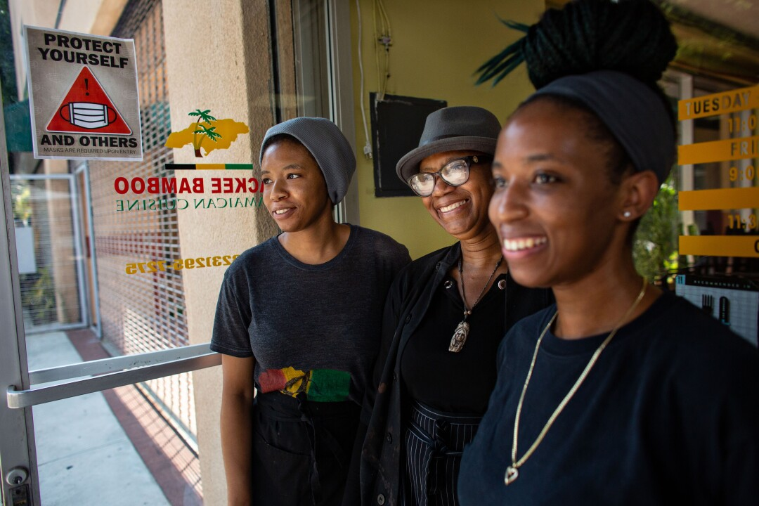 Marlene Sinclair-Beckford, center, opened Ackee Bamboo nearly 15 years ago.