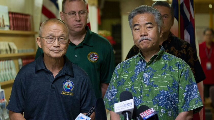 Vern Miyagi, Administrator, HEMA, left, and Hawaii Gov. David Ige addressed the media Saturday, Ja