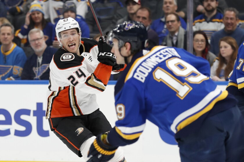 St. Louis Blues' Jay Bouwmeester (19) handles the puck as Ducks' Carter Rowney (24) defends during the first period on Monday in St. Louis.