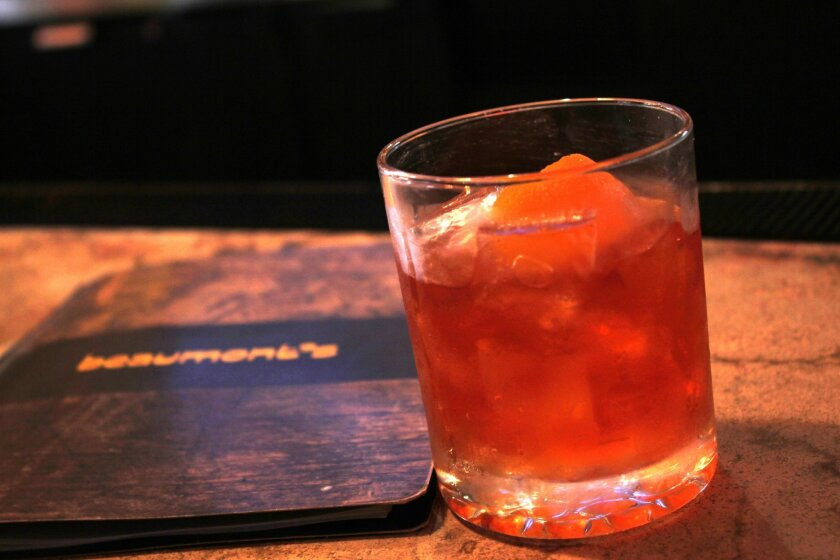 The black walnut Old Fashioned at Beaumont's is something a traditional whiskey fan would like, with an extra sensory kick from its orange bitters and orange zest, according to Gavin McManes.