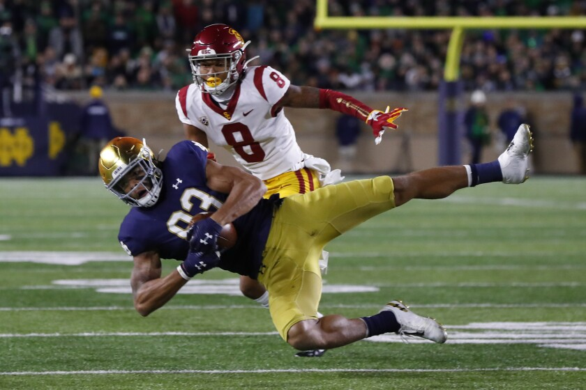 Notre Dame wide receiver Chase Claypool (83) catches a pass as USC cornerback Chris Steele (8) defends in the first half on Saturday in South Bend, Ind.