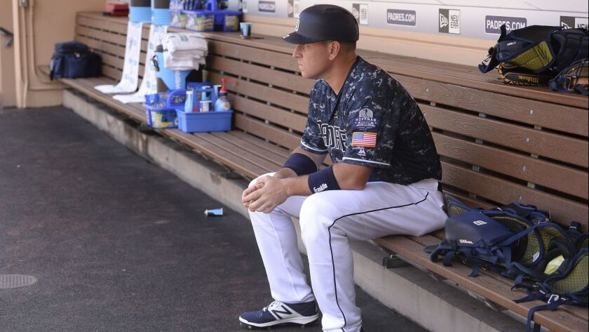 A.J. Ellis looks on from the dugout before a game.