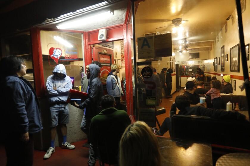 Patrons at Alexander's Hub Burritos listen to the Dirt Babies perform.