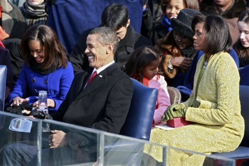 President-elect Barack Obama  laughs as he sits on the inaugural stage during his inauguration as the 44th President of the United States of America on the West Front of the U.S. Capitol Tuesday, Jan 20, 2009, in Washington. (AP Photo/Mark Wilson, Pool)