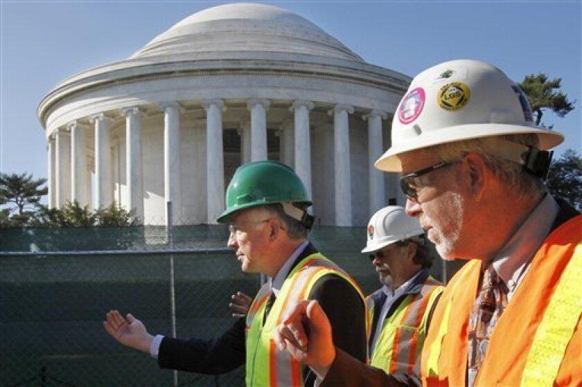Interior Secretary Ken Salazar, left, tours restoration work at the Thomas Jefferson Memorial with Kevin Waldron, and Phil Sheridan, in Washington, Tuesday, Nov. 9, 2010. (AP Photo/Jacquelyn Martin)