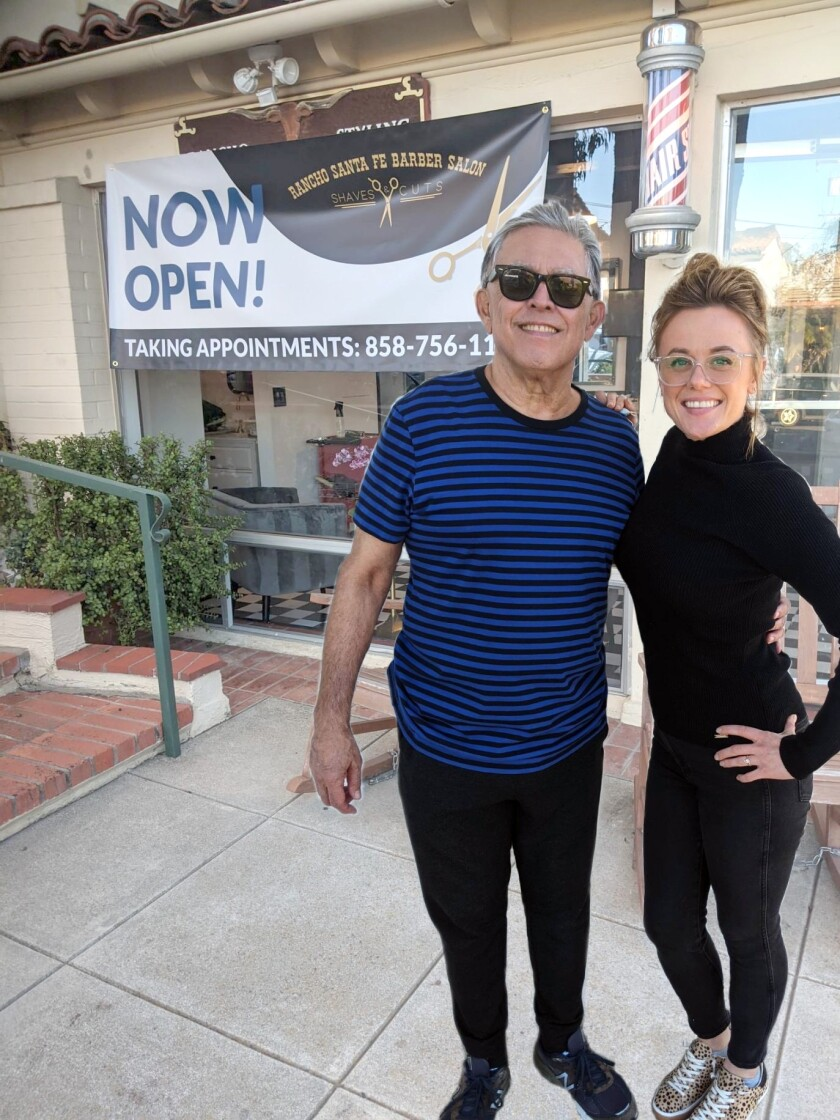 New Rancho Santa Fe Barber Salon owner Juleah Roll with former owner Dan Lara.