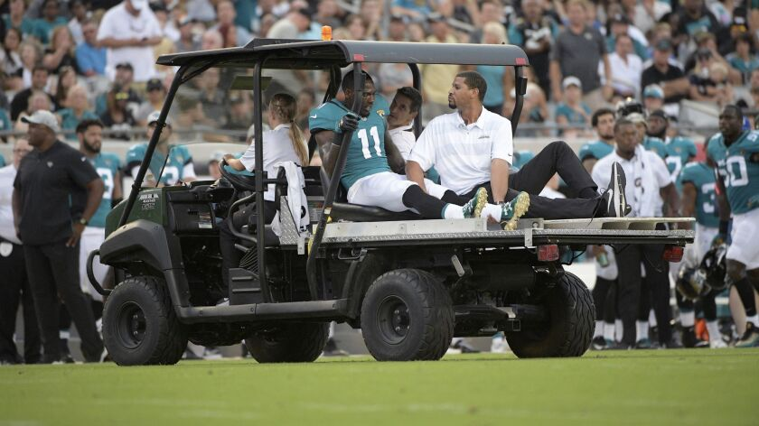 Jacksonville Jaguars wide receiver Marqise Lee is carted off the field after injuring his knee Saturday.