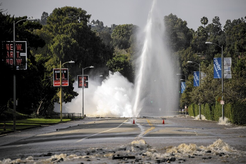 A 100-foot-high geyser caused by a broken 30-inch water main under Sunset Boulevard floods the street and the nearby UCLA campus.