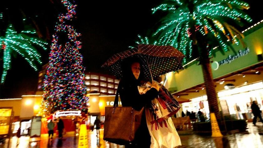 Christmas shoppers at Citadel Outlets in Commerce on Dec. 23. A new survey of consumer confidence in Los Angeles showed a sharp dip in the fourth quarter of 2016.