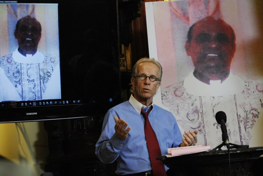 FILE - In this Monday, April 5, 2010 file photo, attorney Jeff Anderson stands between photos of The Rev. Joseph Palanivel Jeyapaul during a news conference in St. Paul, Minn.. The Roman Catholic church in southern India has lifted the suspension of Rev. Joseph Palanivel Jeyapaul convicted last yea