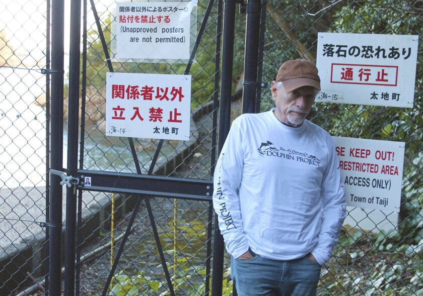 "In this Sept. 16, 2015 photo released by DolphinProject.com, Ric O'Barry poses at a cove in Taiji, Wakayama prefecture, western Japan. Japan has ordered the deportation of the star of the Oscar-winning documentary ""The Cove,"" about a dolphin-killing village in Japan. O'Barry was detained upon arrival Monday, Jan. 18, 2016 at Tokyo's Narita international airport. Japanese authorities decided Friday, Jan. 22 to turn down his appeal to get into the country, according to his son. (DolphinProject.com via AP)"