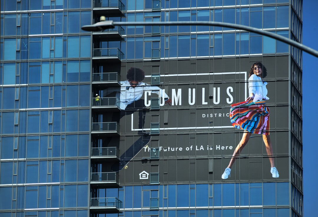 A construction worker takes in the view from a floor of the 30-story residential tower called Arq at Cumulus District