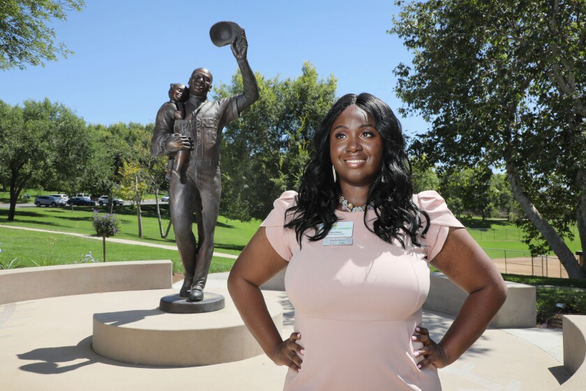 Pierra Moise, hands on hips and standing outside at the Tony Gwynn Memorial at Lake Poway Park