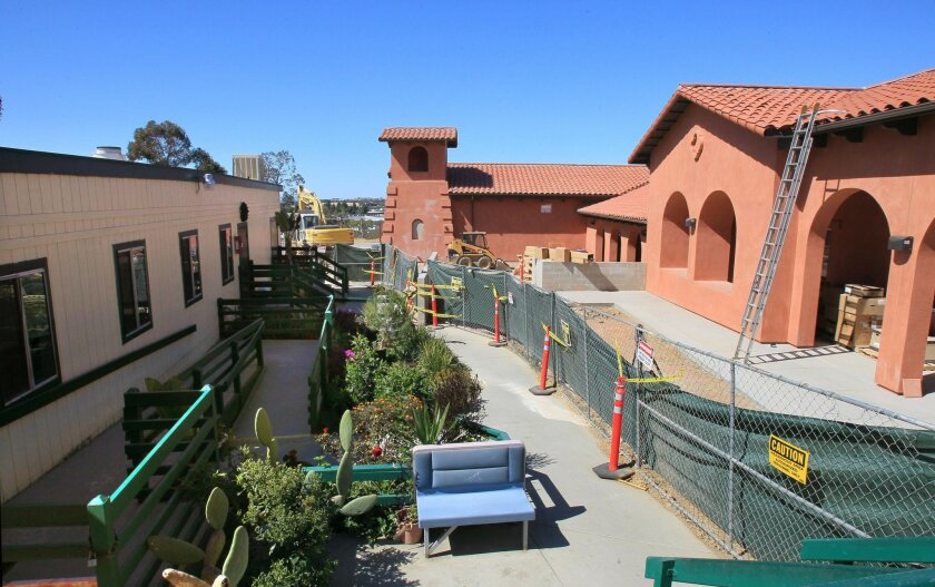 The new building for La Posada in Carlsbad is seen at right, next to the original portable buildings at left that will be removed when the new structure is completed. CHARLIE NEUMAN • U-T