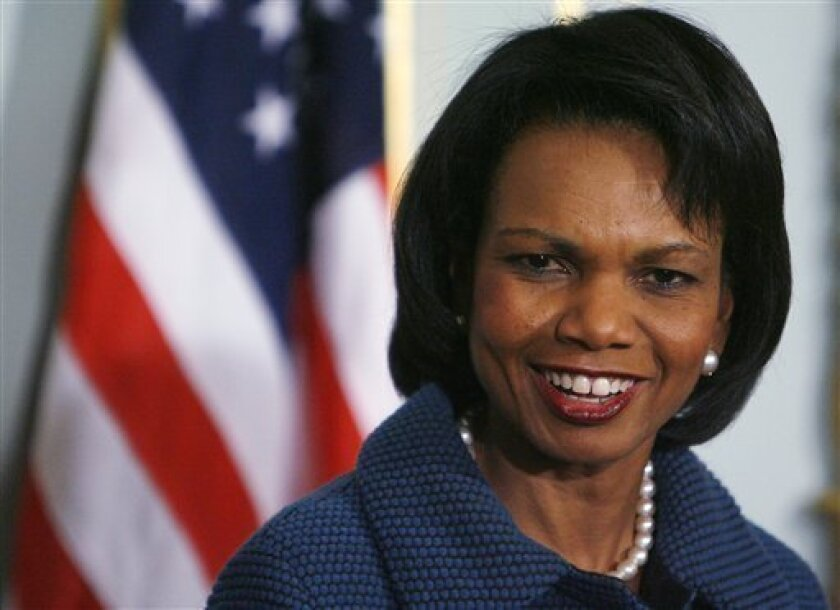 U.S. Secretary of State Condoleezza Rice smiles during a press conference with Britain's Foreign Secretary David Miliband after their meeting in London, Monday, Dec. 1, 2008. President-elect Barack Obama announced Monday that Hillary Rodham Clinton will be the next Secretary of State. (AP Photo/Akira Suemori)