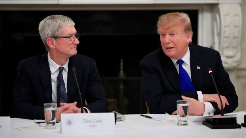 President Donald Trump acknowledges Apple CEO Tim Cook on March 6, 2019, at the American Workforce Policy Advisory Board's first meeting in the State Dining Room of the White House in Washington.