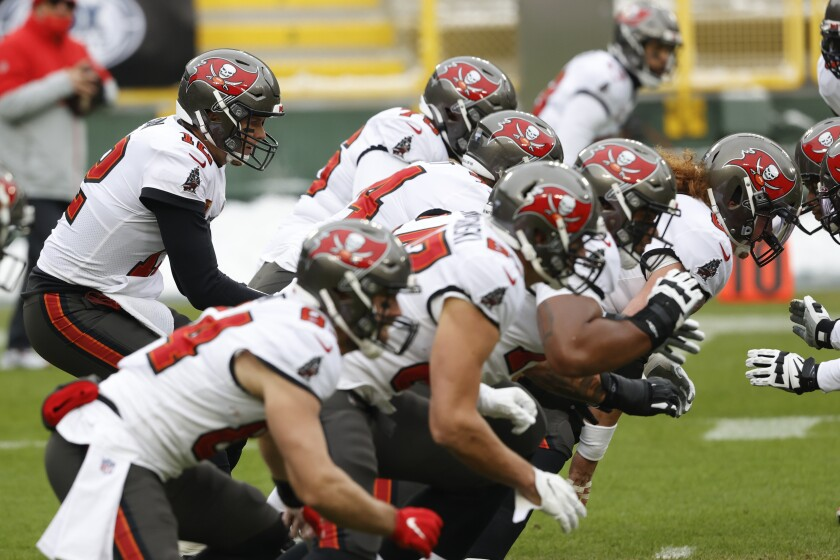 Tampa Bay Buccaneers quarterback Tom Brady takes a snap during warmups.
