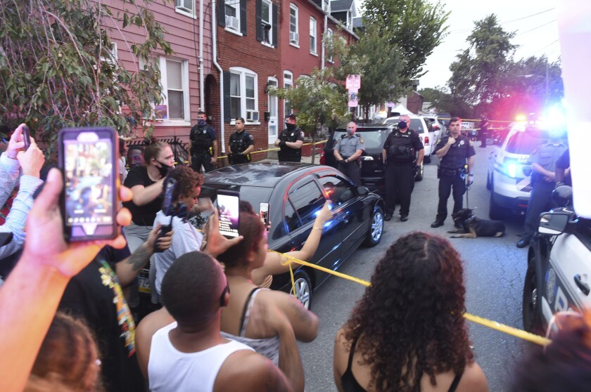 People chant during a protest at the scene of a police shooting on Laurel Street and Union Street in Lancaster city on Sunday, Sept. 13, 2020.A man was shot by police earlier in the day after a reported domestic dispute, police said. A Lancaster city police officer fired at a 27-year-old man who was armed with a knife. The man, identified as Ricardo Munoz, was killed and pronounced dead at the scene, (Andy Blackburn/LNP/LancasterOnline via AP)