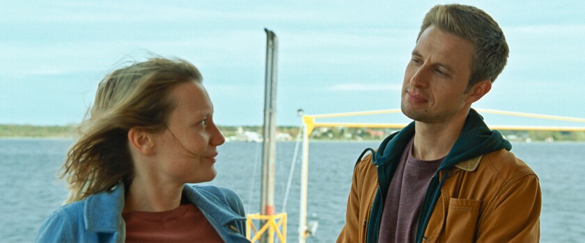 """A couple look meaningfully at each other in the movie """"Bergman Island."""""""