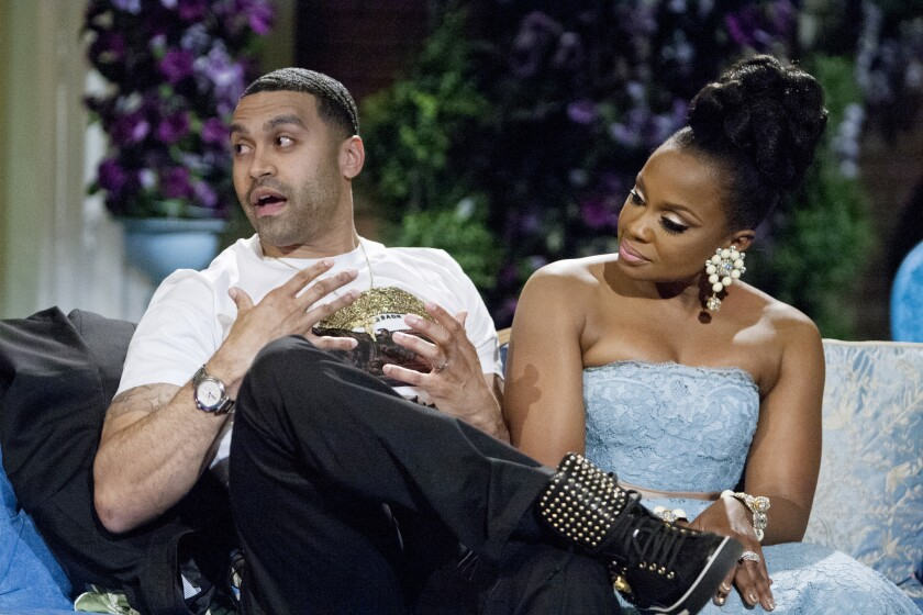 """Apollo Nida, shown with wife Phaedra Parks during the taping of a """"Real Housewives of Atlanta"""" reunion special in March, was sentenced Tuesday to eight years in federal prison."""