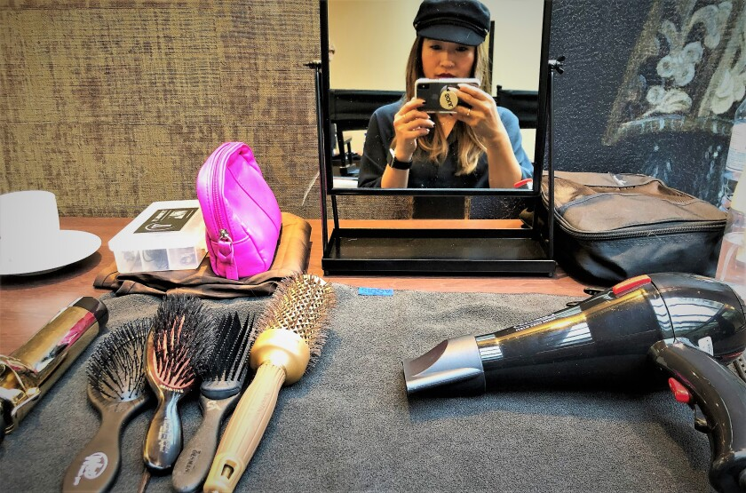 La Jolla hair stylist Cheng Tan takes time out for a selfie with her tools of the trade backstage during Fashion Week in Paris, where she helped groom Balenciaga haute couture models for the runway.