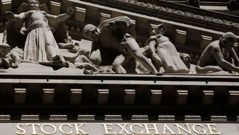 FILE - This July 15, 2013, file photo, shows the New York Stock Exchange. Stocks are rising, Wednesd