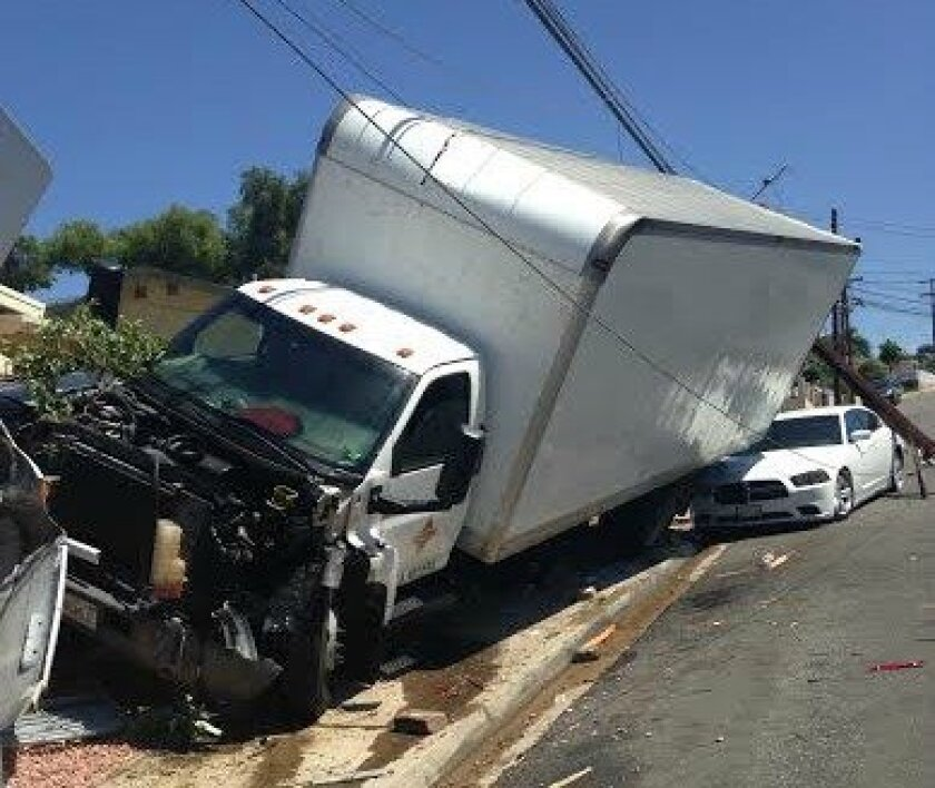 A driverless moving truck crashed into two parked vehicles and a power line Sunday near the San Diego Oak Park neighborhood.