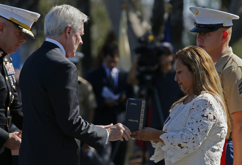 Rosa Peralta accepts the Navy Cross from Secretary of the Navy Ray Mabus on behalf of her son Marine Sgt. Rafael Peralta, who was killed in Iraq, at a ceremony at Camp Pendleton on Monday. Many say he deserved the Medal of Honor.