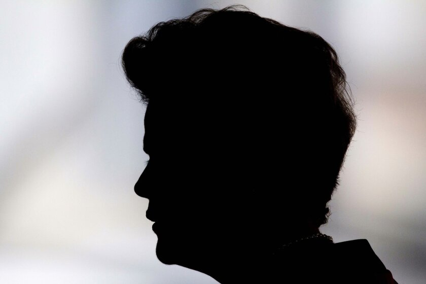 """FILE - In this July 17, 2015 file photo, Brazil's President Dilma Rousseff arrives for a Mercosur Summit at Itamaraty Palace in Brasilia, Brazil. If the worst economic crisis in a decade, a massive corruption scandal centered on her ruling party and approval ratings in the single digits weren't rough enough for Brazilian President Dilma Rousseff, she's now faced with a """"political suicide bomber."""" That would be powerful Dep. Eduardo Cunha, the speaker of Brazil's lower house of Congress. He's Rousseff's sworn enemy who has been charged with taking millions in bribes in connection to a sprawling corruption scandal at state-run oil company Petrobras. (AP Photo/Joedson Alves, File)"""