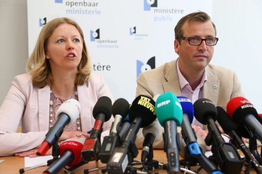Anja Bijnens and Jean-Marc Meilleur of the Brussels prosecutor's office announce the arrest of 31 people in connection with a spectacular diamond heist at a Belgian airport.