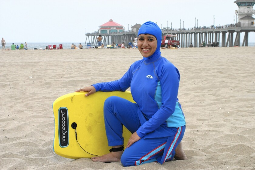 The Splashgear full-coverage swimwear line includes a hood and a one-piece skirted pair of swim bottoms.
