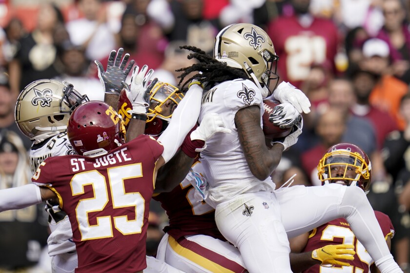 New Orleans Saints wide receiver Marquez Callaway (1) catches a Hail Mary pass for a touchdown in the first half of an NFL football game against the Washington Football Team, Sunday, Oct. 10, 2021, in Landover, Md. (AP Photo/Julio Cortez)