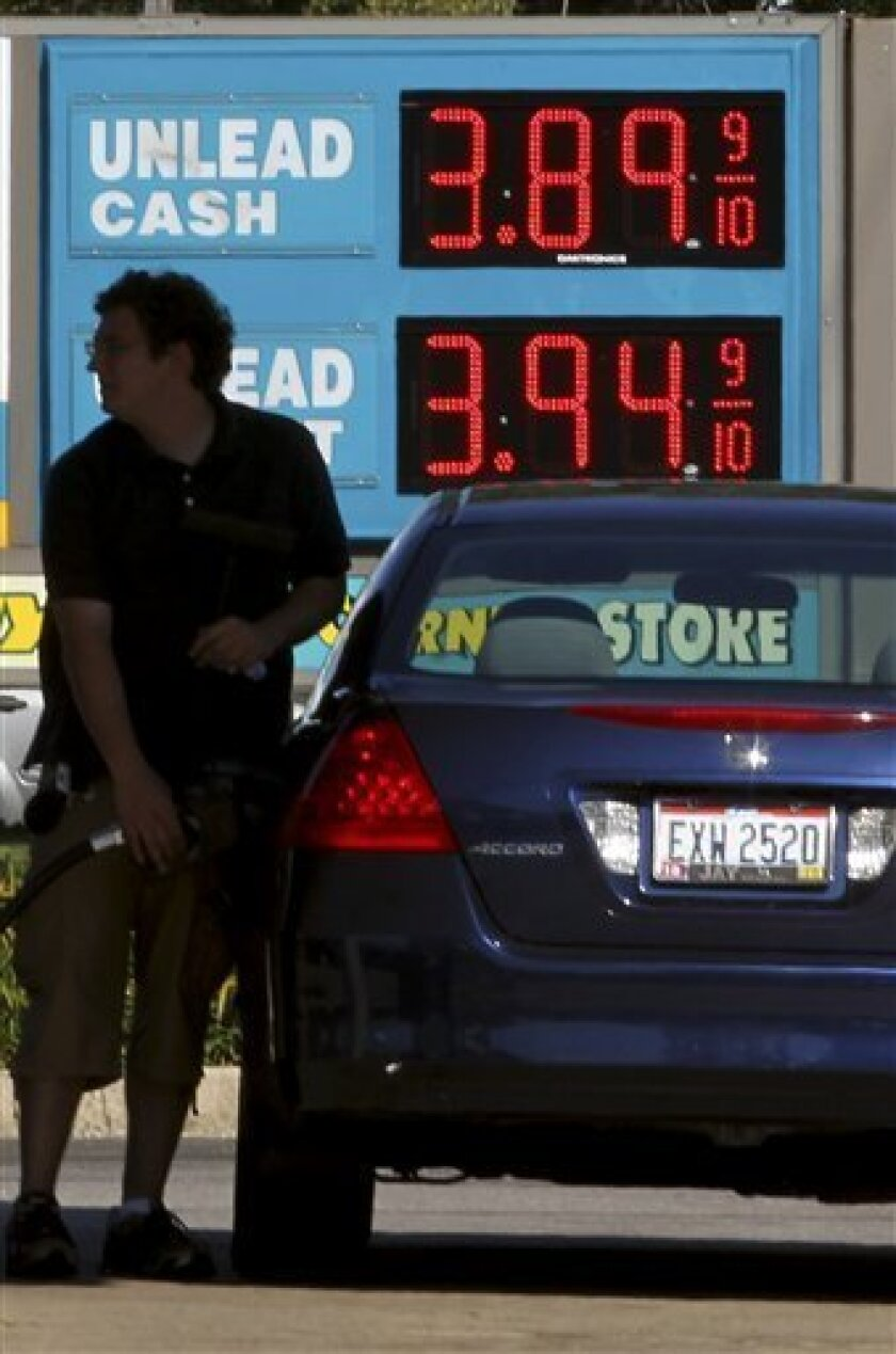 FILE - In this Wednesday, Aug. 29, 2012 file photo, a man fills his gas tank at a gas station in Lyndhurst, Ohio. The big spike in gasoline prices is just about over, but it's too late to bring much relief for Labor Day weekend. The national average price for gasoline inched up just 0.3 cents Frida